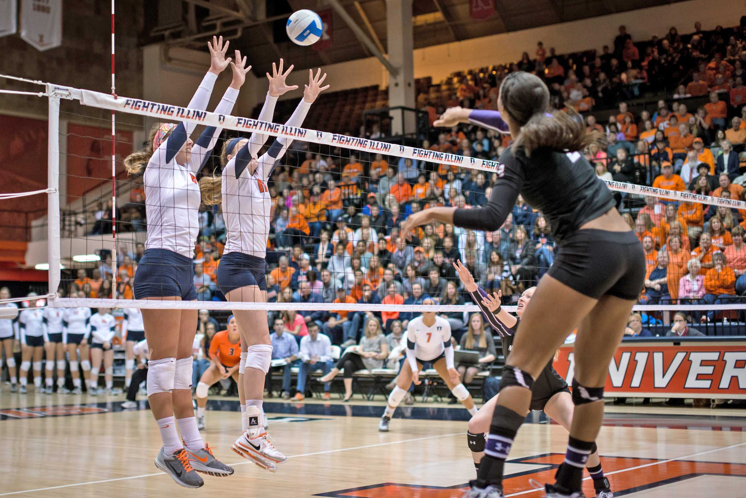 Illinois' Katie Stadick (12) attempts to block a spike during the match against Northwestern at Huff Hall on Saturday, November 8, 2014. The Illini won 3 of 4 sets.