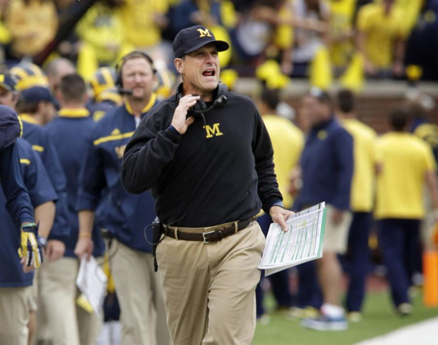 Michigan head coach Jim Harbaugh gives instructions to his team during first-half action against Oregon State at Michigan Stadium in Ann Arbor, Mich., on Saturday, Sept. 12, 2015. Michigan won, 35-7. (Diane Weiss/Detroit Free Press/TNS)