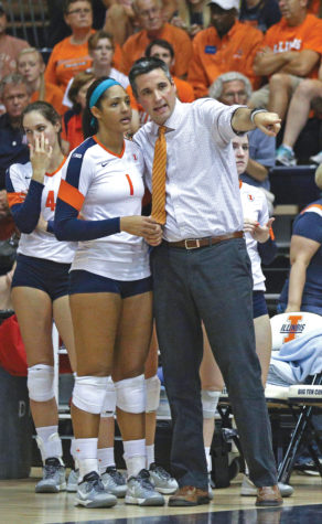 Illinois' head coach Kevin Hambly talks to Morganne Criswell (1) during the game against Rutgers at George Huff Hall, on Saturday, Sept. 27th. The Illini won 3-0.