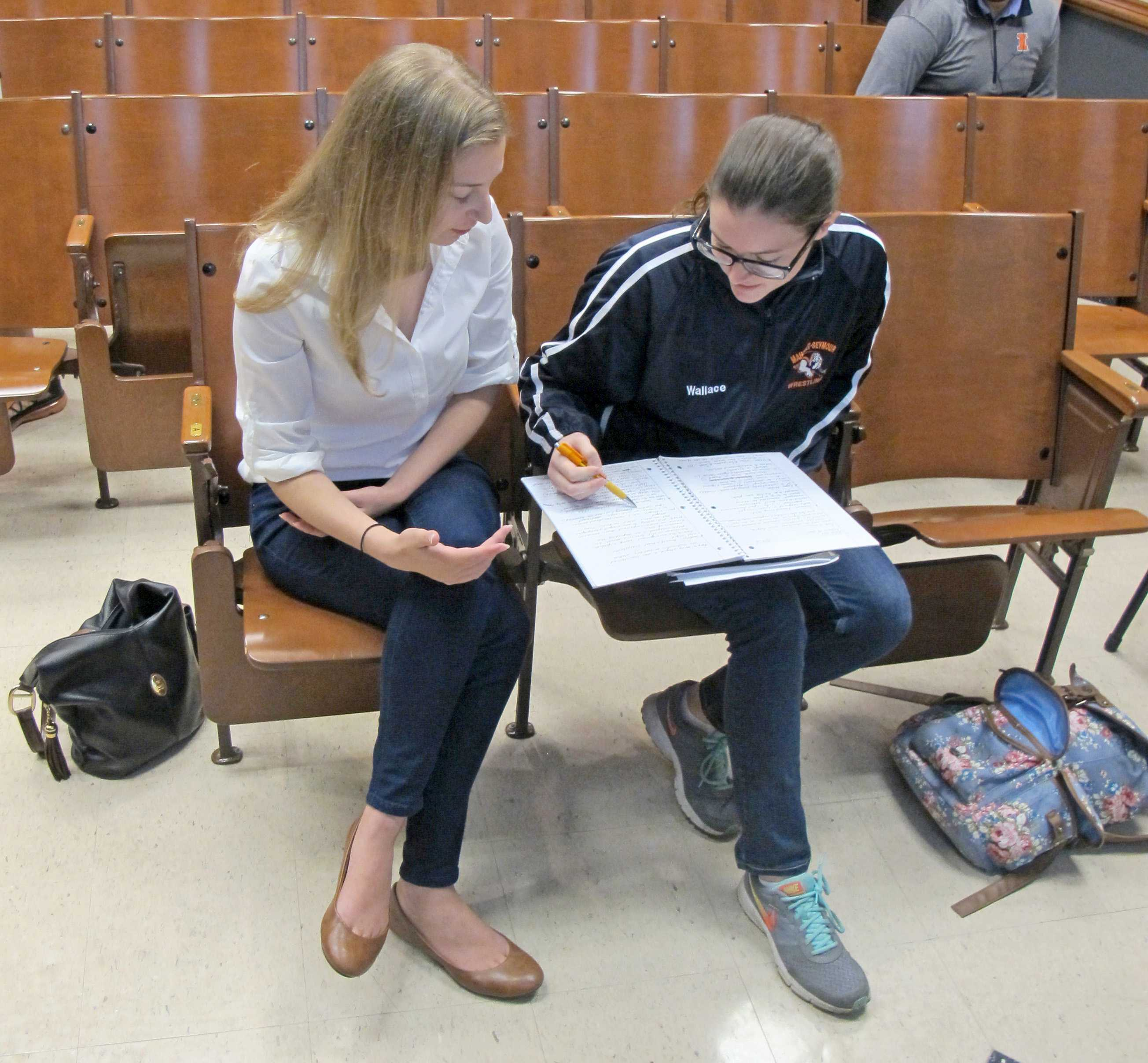 A T.A. helps a student prepare for her History of Photography midterm exam.