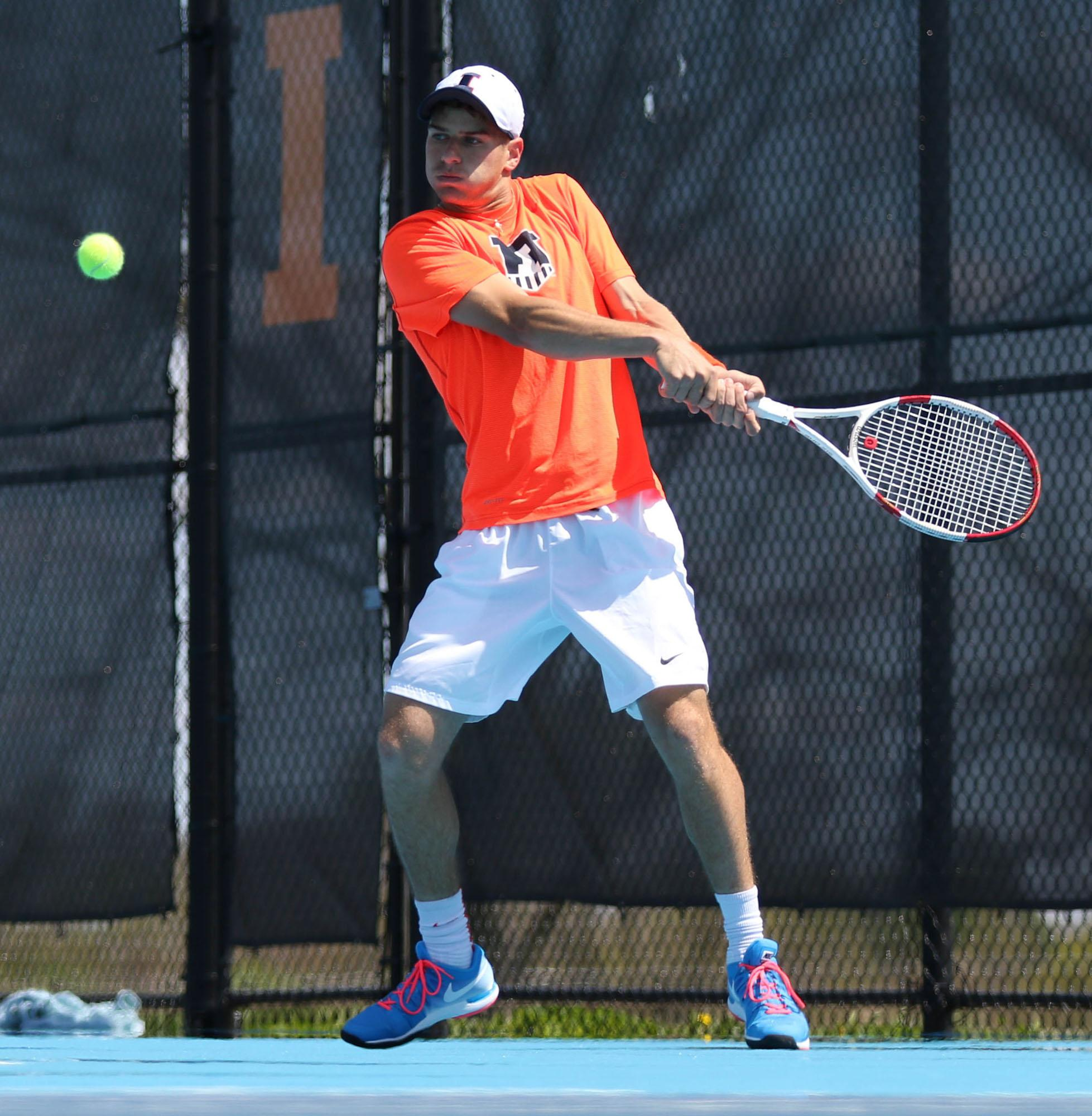 Illinois Aron Hiltzik attempts to return the ball during the Big Ten Men's Tennis Tournament final against Ohio State at the Khan Outdoor Tennis Complex, on Sunday, April 26, 2015. The Illini won 4-0.