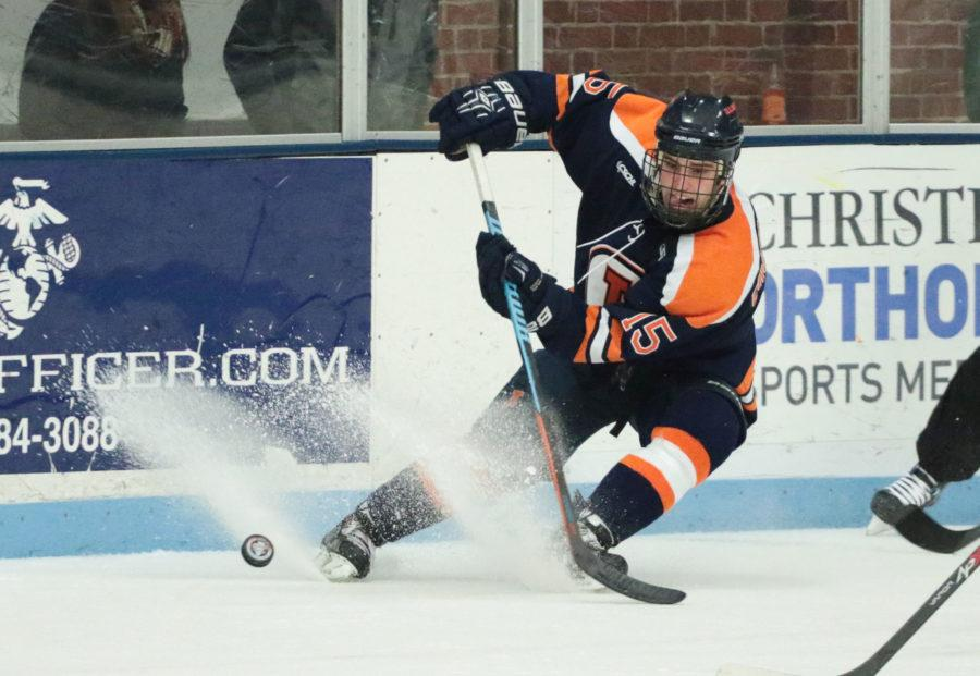 Illinois' Eric Cruickshank (15) makes a short pass during the CSCHL Playoffs semi-finals v. Ohio University at the Ice Arena on Saturday, Feb. 21, 2015. Illinois lost 3-5.