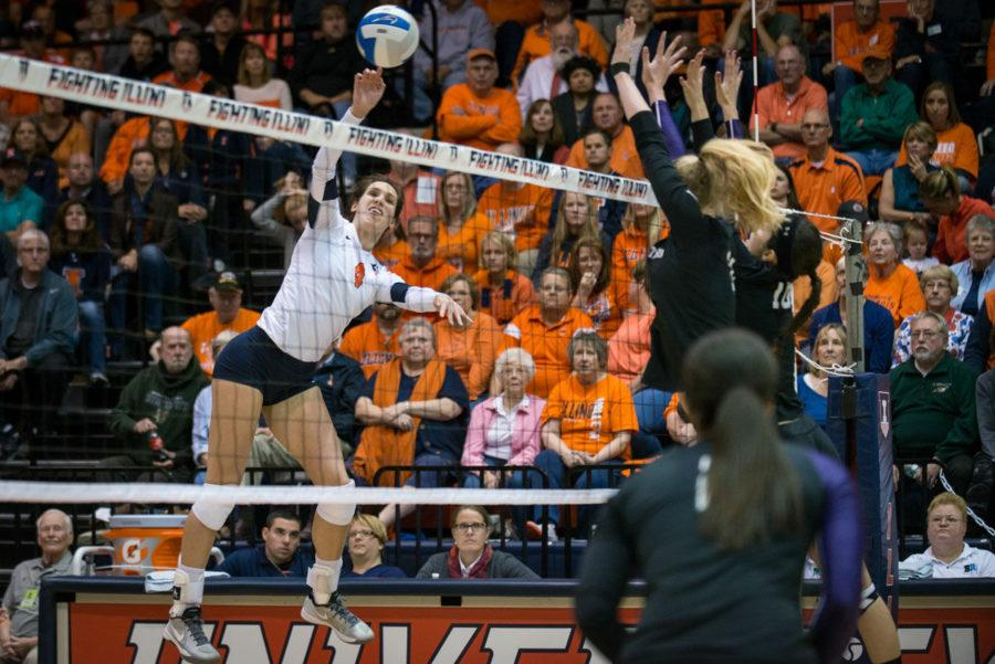 Illinois' Michelle Strizak spikes the ball past Northwestern's block during the volleyball game against Northwestern at Huff Hall on Saturday. Strizak finished with six kills.