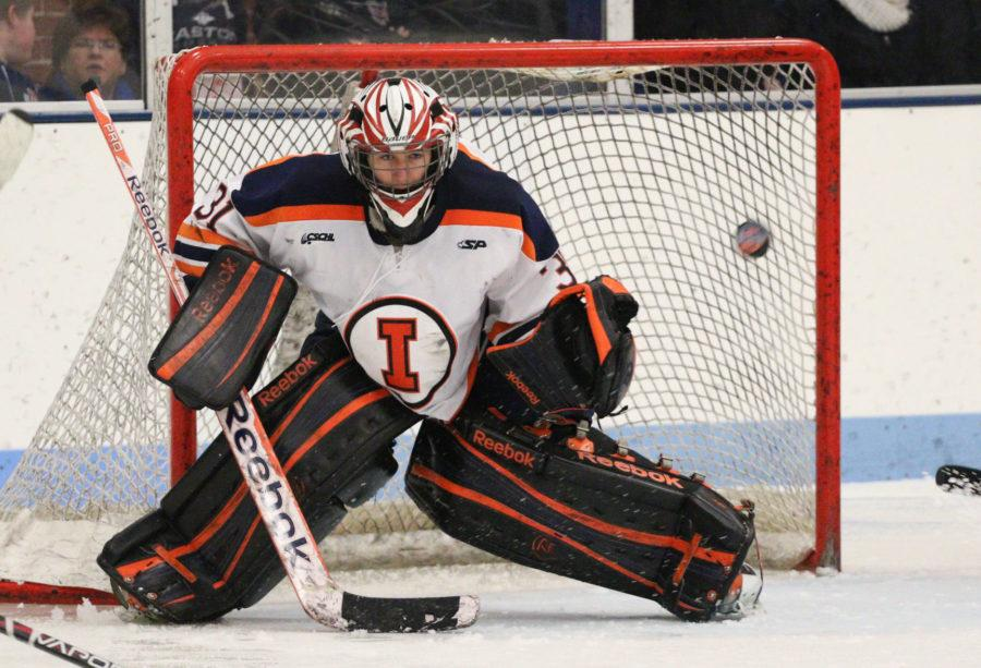 Illinois' Joe Olen (31) attempts to block a shot during the hockey game vs. Robert Morris at the Ice Arena on Saturday, Jan. 24, 2015. The Illini lost 4-3.