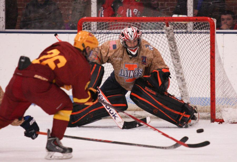 Illinois' Joe Olen defends a shot from Iowa State's Nate Percy during Friday's 3-1 Illini win.