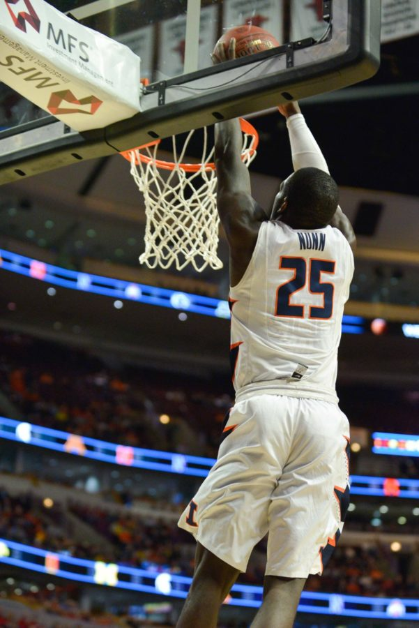 Illinois' Kendrick Nunn (25) dunks the ball off a fast break during the game against Michigan at United Center in Chicago, Illinois during the Big Ten Tournament on Thursday, March 12, 2015. The Illini lost 73-55.
