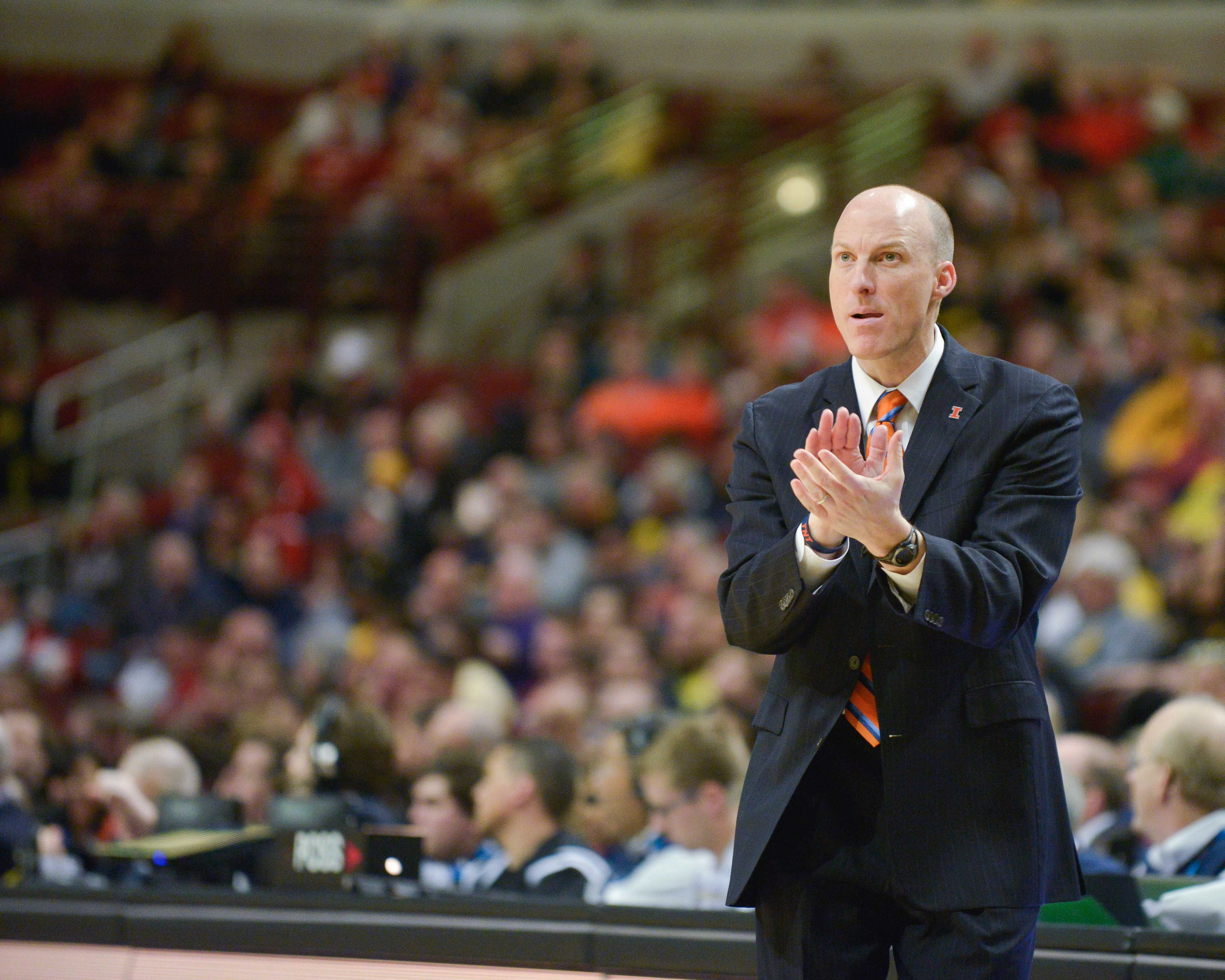 Illinois' head coach John Groce claps after a Michigan turnover during the game at United Center in Chicago, Illinois during the Big Ten Tournament on Thursday, March 12, 2015.