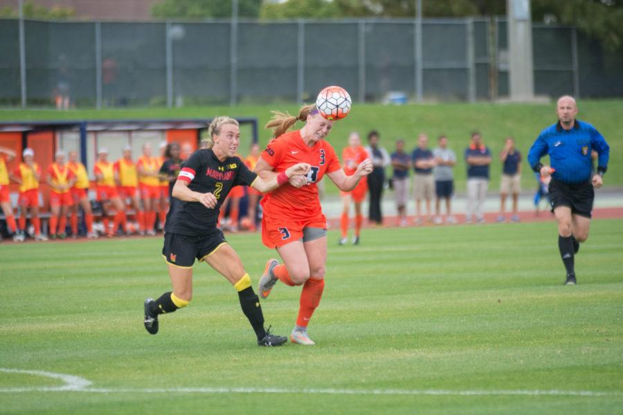 Jannelle+Flaws+heads+the+ball+forward+during+the+game+against+Maryland+at+Illinois+Soccer+and+Track+Stadium+on+Thursday.+Illinois+won+2-1+in+double+overtime.