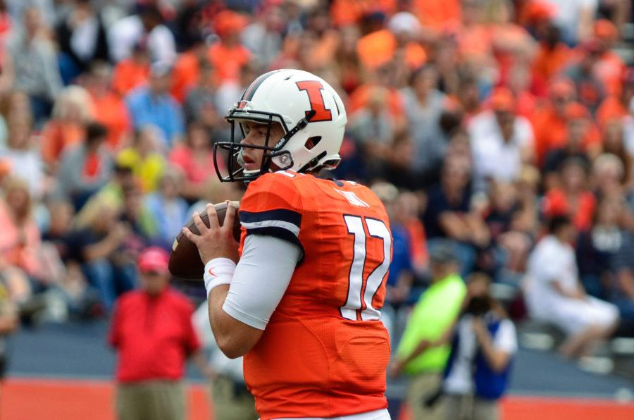 Illinois%27+Wes+Lunt+%2812%29+attempts+to+pass+the+ball+during+the+game+against+Western+Kentucky+at+Memorial+Stadium+on+Saturday%2C+Sept.+6%2C+2014.+The+Illini+won+42-34.