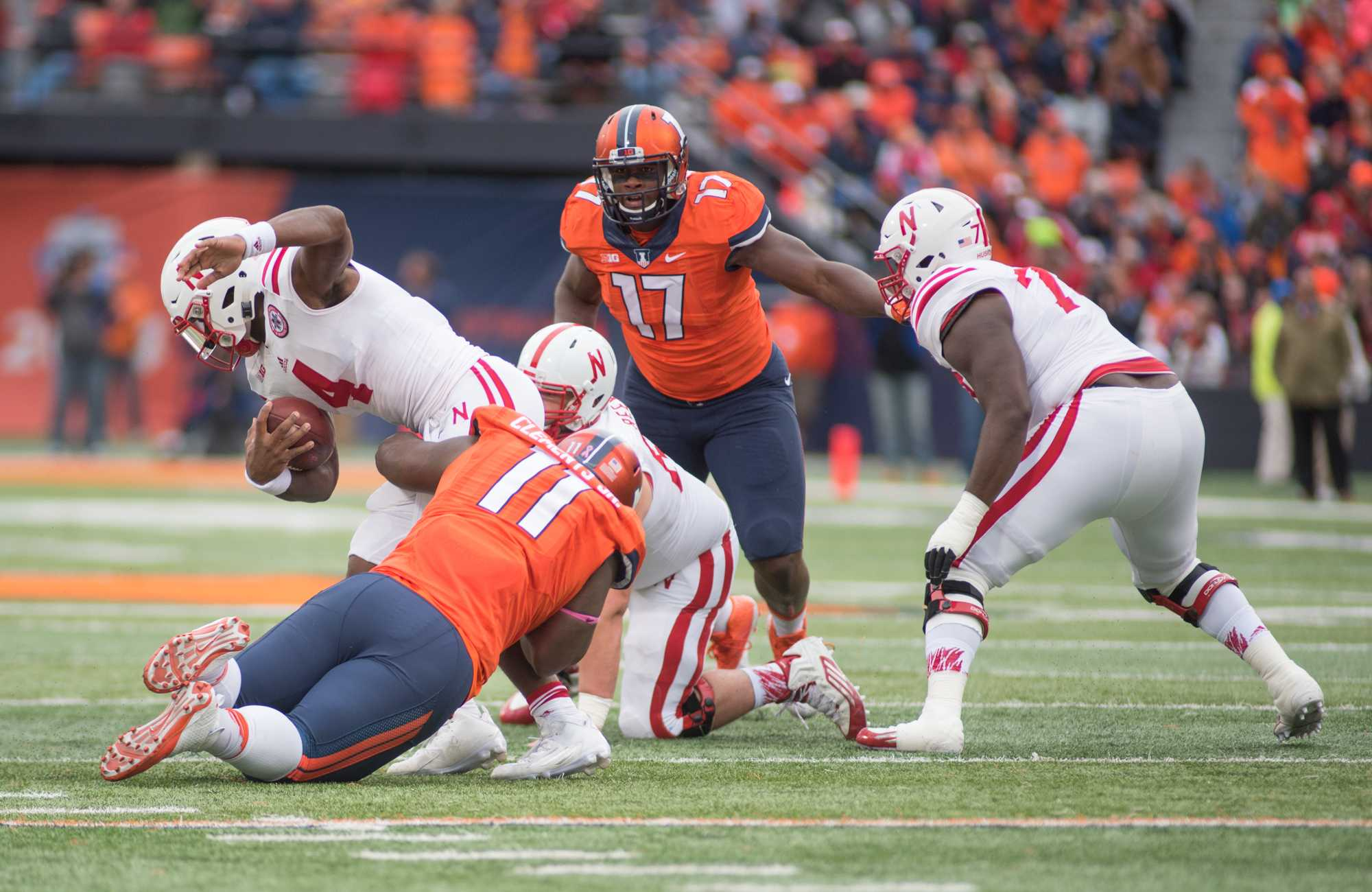 Chunky Clements drags down Nebraska quarterback Tommy Armstrong Jr. during Illinois' 14-13 win over Nebraska at Memorial Stadium on Oct. 3.