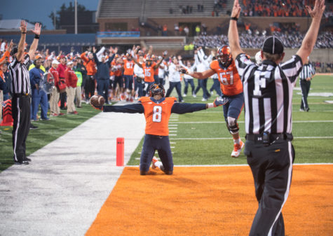 Wide receiver Geronimo Allison celebrates after catching the game-winning touchdown pass with 10 seconds left in Illinois' 14-13 win over Nebraska at Memorial Stadium on Oct. 3.