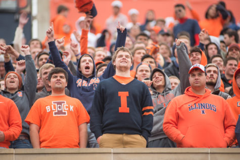 Members of Illinois' student section, Block I, cheer on the Fighting Illini during their game against Nebraska on Saturday at Memorial Stadium. Illinois won 14-13.