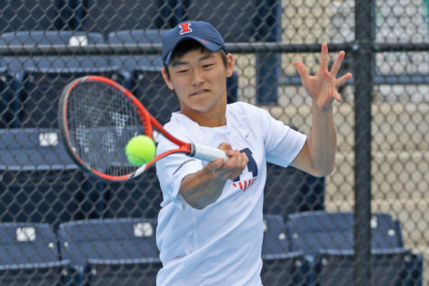 Illinois' Toshiki Matsuya makes a return during the Big Ten Tennis Tournament quarterfinals v. Iowa at Atkins Tennis Center on Friday, Apr. 24, 2015. Illinois won 4-0.