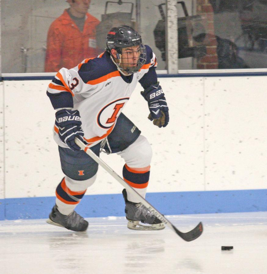 Illinois' Austin Zima (3)  moves the puck away from Illinois' goal during the Ohio hockey game at the Ice Arena on Friday, October 24, 2014. The Illini won 2-1.