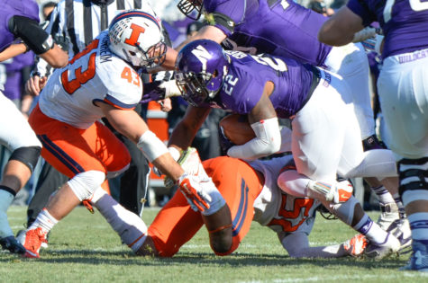 Illinois' Mason Monheim (43) and T.J. Neal (52) tackle Northwestern 's Treyvon Green (22) during the game at Ryan Field in Evanston, Ill. on Saturday, Nov. 29, 2014. The Illini won 47-33.