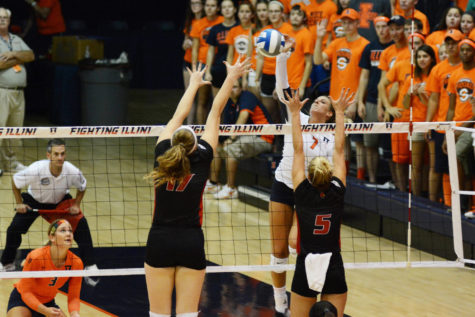 Illinois' Jocelynn Birks (7) spikes the ball during the game versus Louisville at Huff Hall on Friday, August 28, 2015.The Illini won 3-0.
