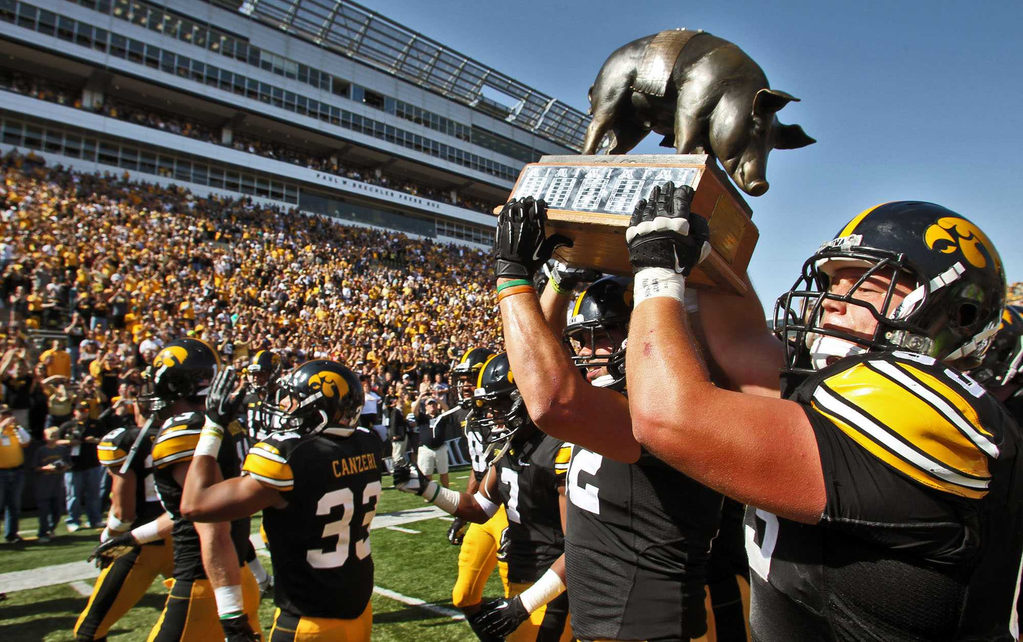 Iowa players carried the Floyd of Rosedale trophy off the field following a 31-13 victory over Minnesota at Kinnick Stadium in Iowa City, Iowa, Saturday, September 29, 2012. (Marlin Levison/Minneapolis Star Tribune/MCT)
