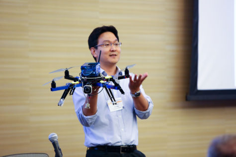 Aerospace Engineering professor Soon-Jo Chung holds a quadcopter while speaking at Share the Vision 2013, an annual research and start-up showcase sponsored by the Office of Technology Management and EnterpriseWorks.