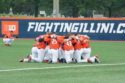 The Illini baseball team huddles before the start of their game against Notre Dame on May 30 at Illinois Field.
