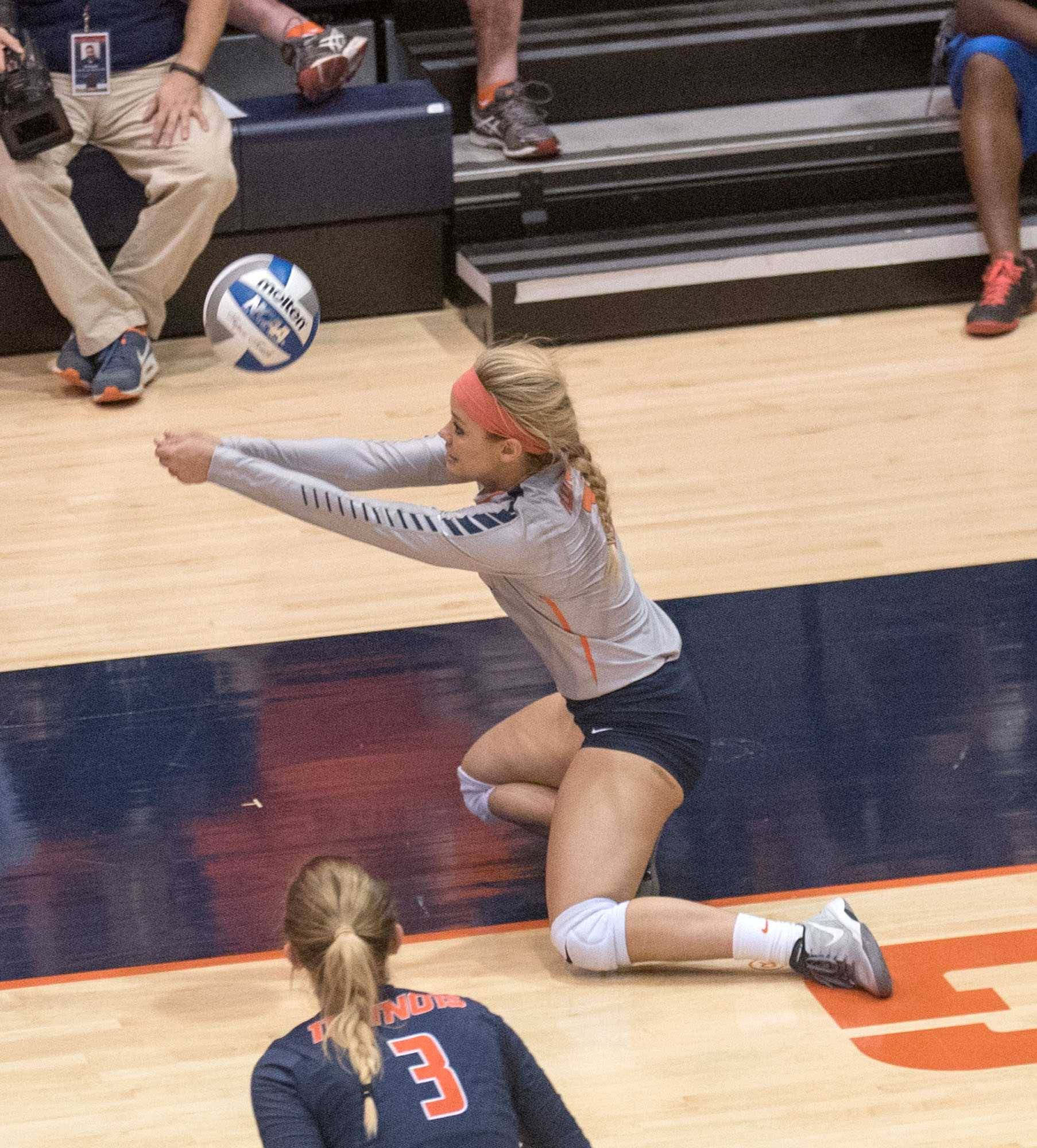 Julia Conard digs the ball during Friday's game against Penn State. Illinois lost 1-3.