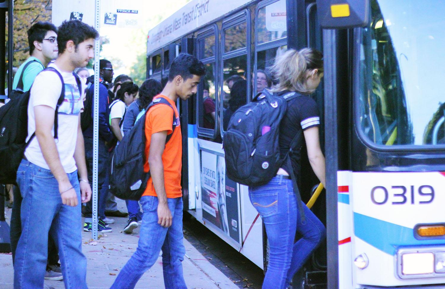 Students getting on a MTD bus at the bus stop in front of Illini Union Bookstore on October 12, 2015.