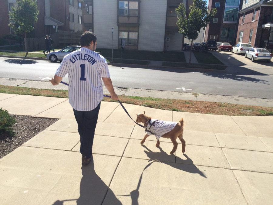 Littleton the Goat goes for a walk with his owner, Evan Marinis, a UI student, who sports a customized Littleton jersey.