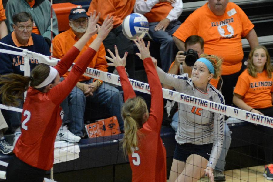 Illinois' Katie Stadick (12) spikes the ball during the match against Nebraska at Huff Hall on Saturday, Oct 17, 2015. Illinois lost 0-3.