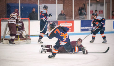 Left winger Jack Soneson takes a shot on goal during Illinois' 5-3 victory over Robert Morris at the Ice Arena on Saturday night.
