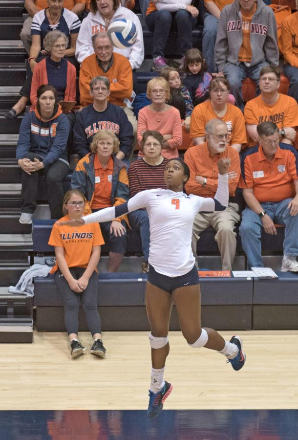 Naya+Crittenden+jumps+to+spike+the+ball+against+Iowa+last+year+at+Huff+Hall.+Illinois+won+3-0.