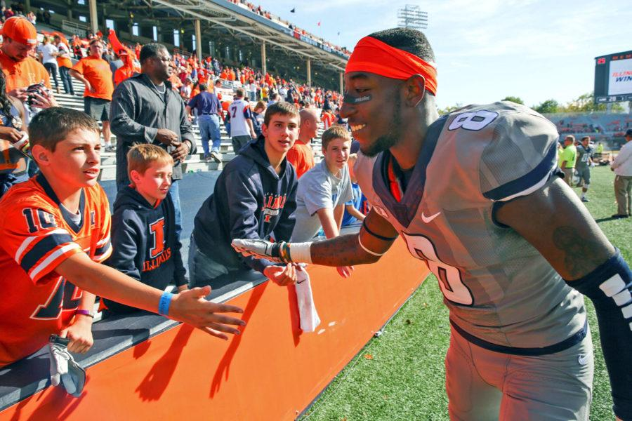 Illinois%27+Geronimo+Allison+%288%29+gives+high-fives+to+young+fans+after+the+homecoming+game+against+Minnesota+at+Memorial+Stadium+on+Saturday%2C+Oct.+25%2C+2014.+The+Illini+won+28-24.