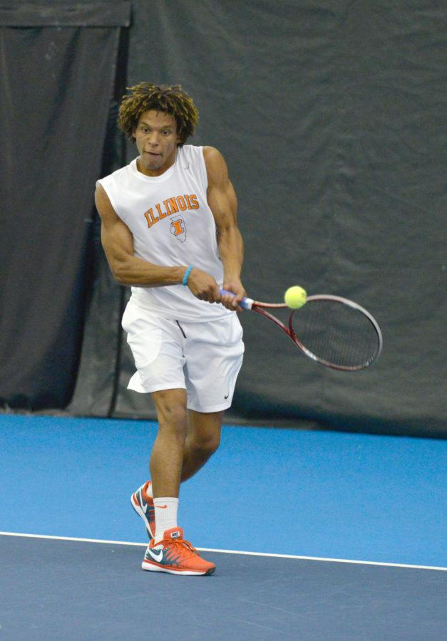 Illinois Julian Childers hits the ball during the match against No. 8 Texas at Atkins Tennis Center on Sunday, Feb. 9, 2014. The Illini won 4-3.