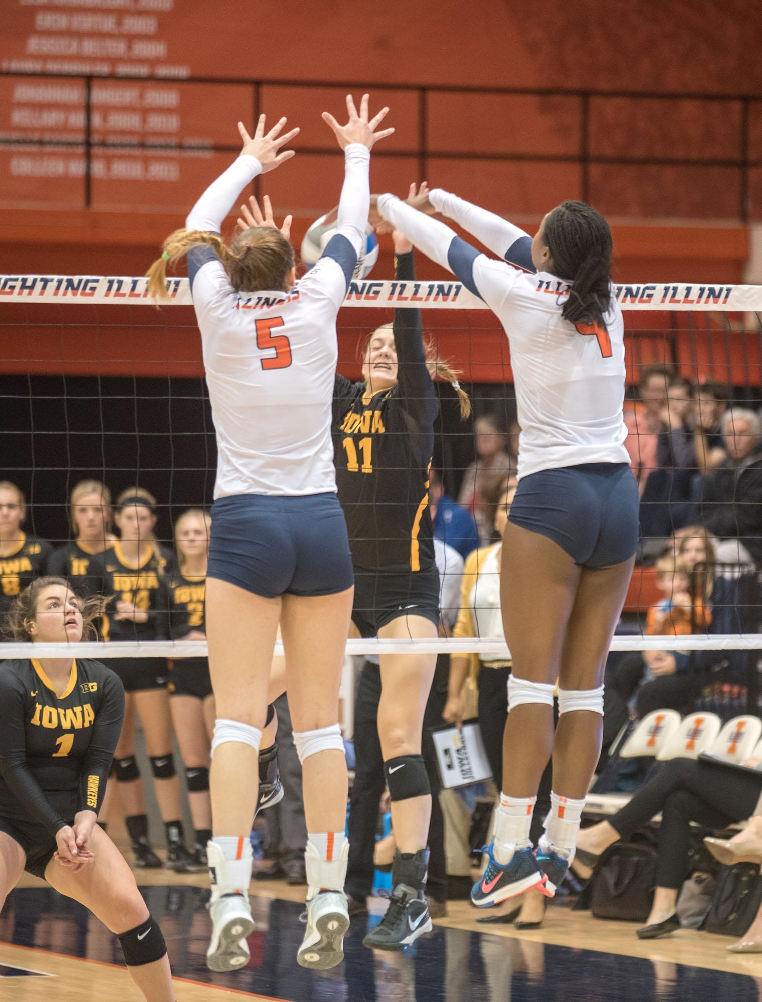 (right) Naya Crittenden stuffs an Iowa attack during Illinois' 3-0 win at Huff Hall on Friday.