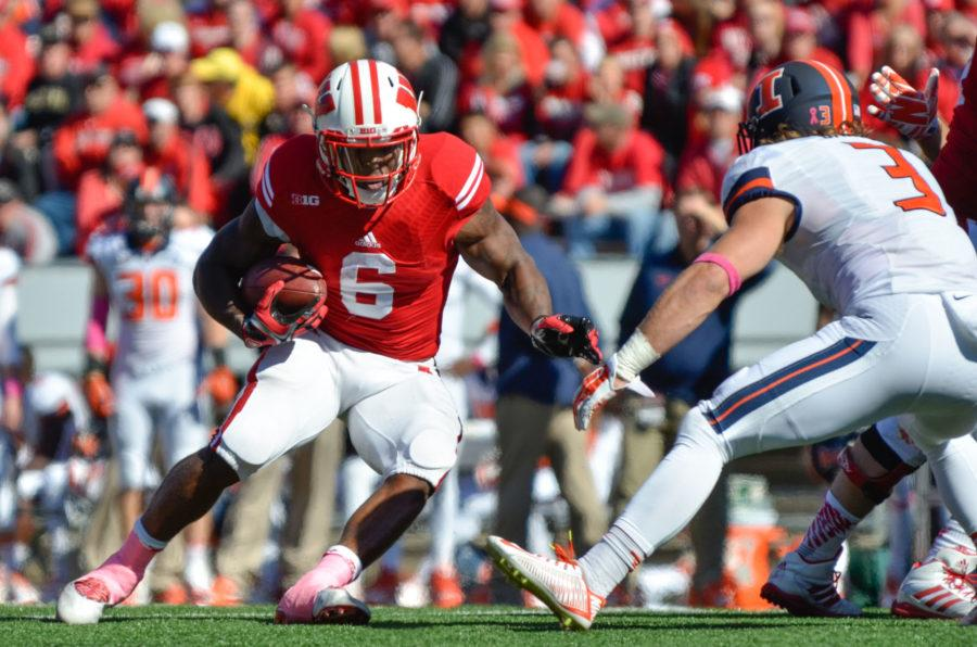 Wisconsin%27s+Corey+Clement+%286%29+runs+the+ball+during+the+game+at+Camp+Randall+Stadium+in+Madison%2C+Wis.+on+Saturday%2C+Oct.+11%2C+2014.+The+Illini+lost+38-28.
