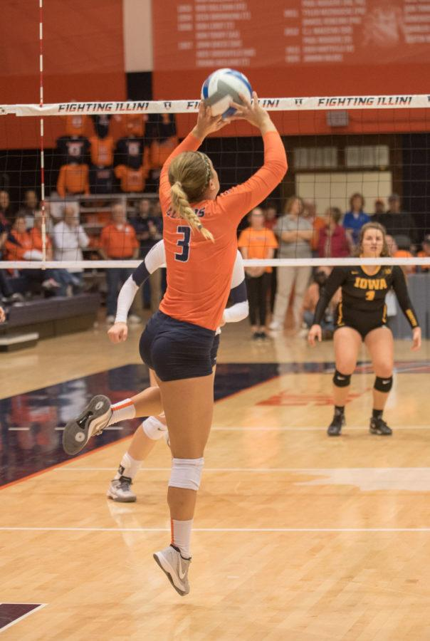 Brandi Donnelly sets the ball during the game against Iowa at Huff Hall on Friday. Illinois won 3-0.