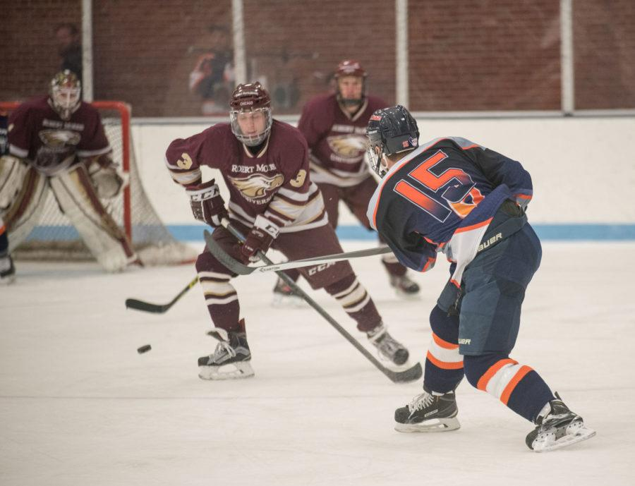 Left winger Eric Cruickshank takes a shot on goal against Robert Morris on Saturday at the Ice Arena. Illinois won 5-3 and Cruickshank had three goals and an assist.