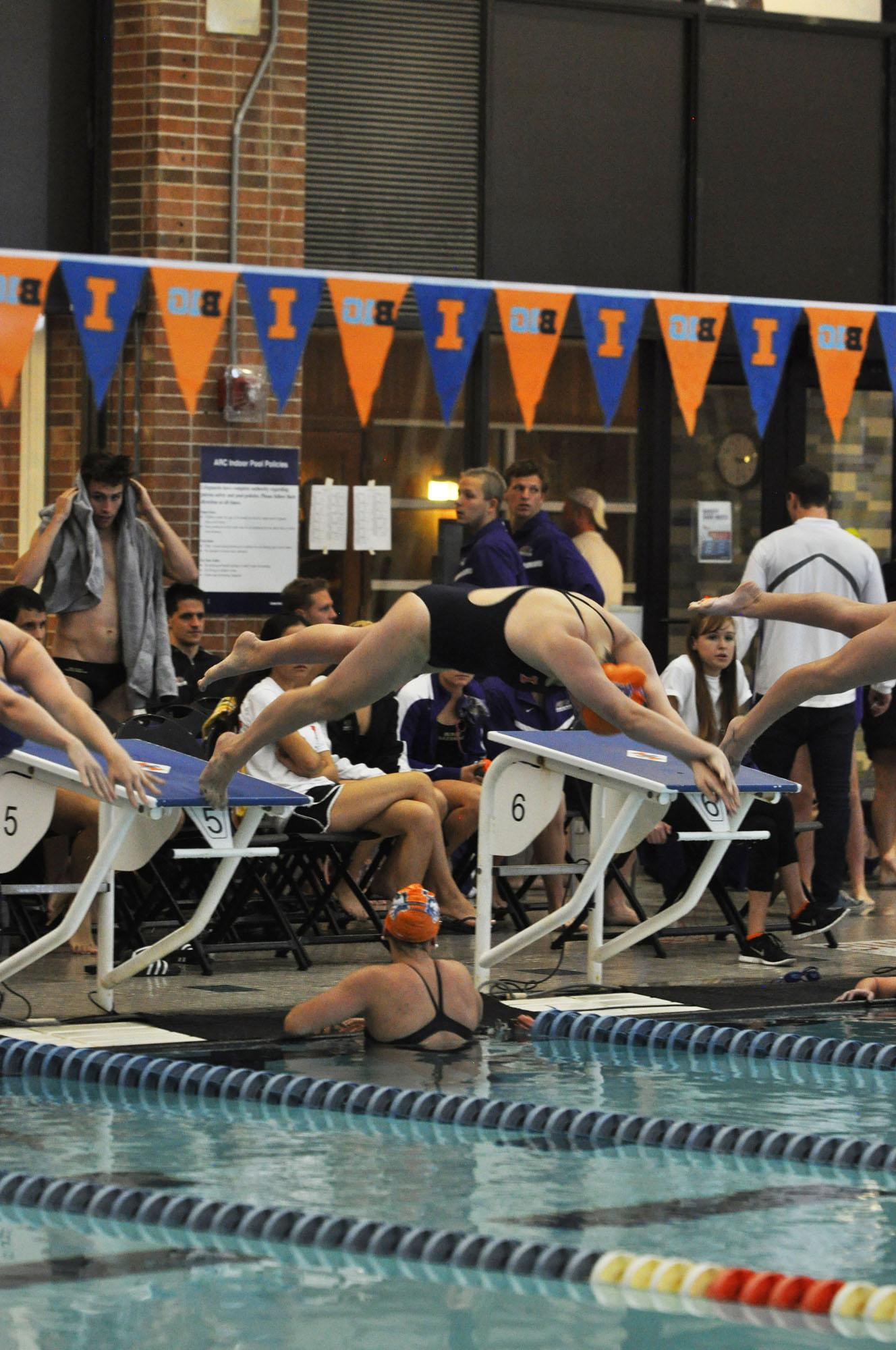 Amelia Schilling, junior, dives off the block for the 500 yard freestyle at the Fighting Illini Dual Meet Spectacular in the ARC Pool on October 16, 2015.