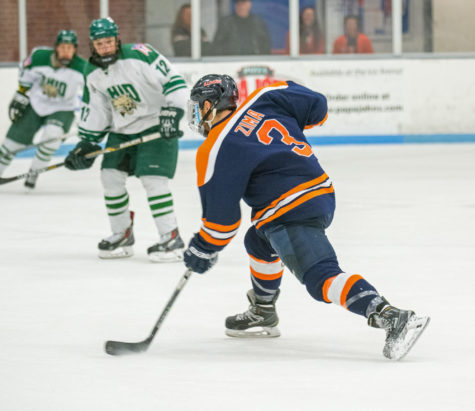 Defenseman Austin Zima fires a shot on goal during the game against Ohio University at the Ice Arena on Saturday, October 24. Illinois lost 2-3 in the shootout.