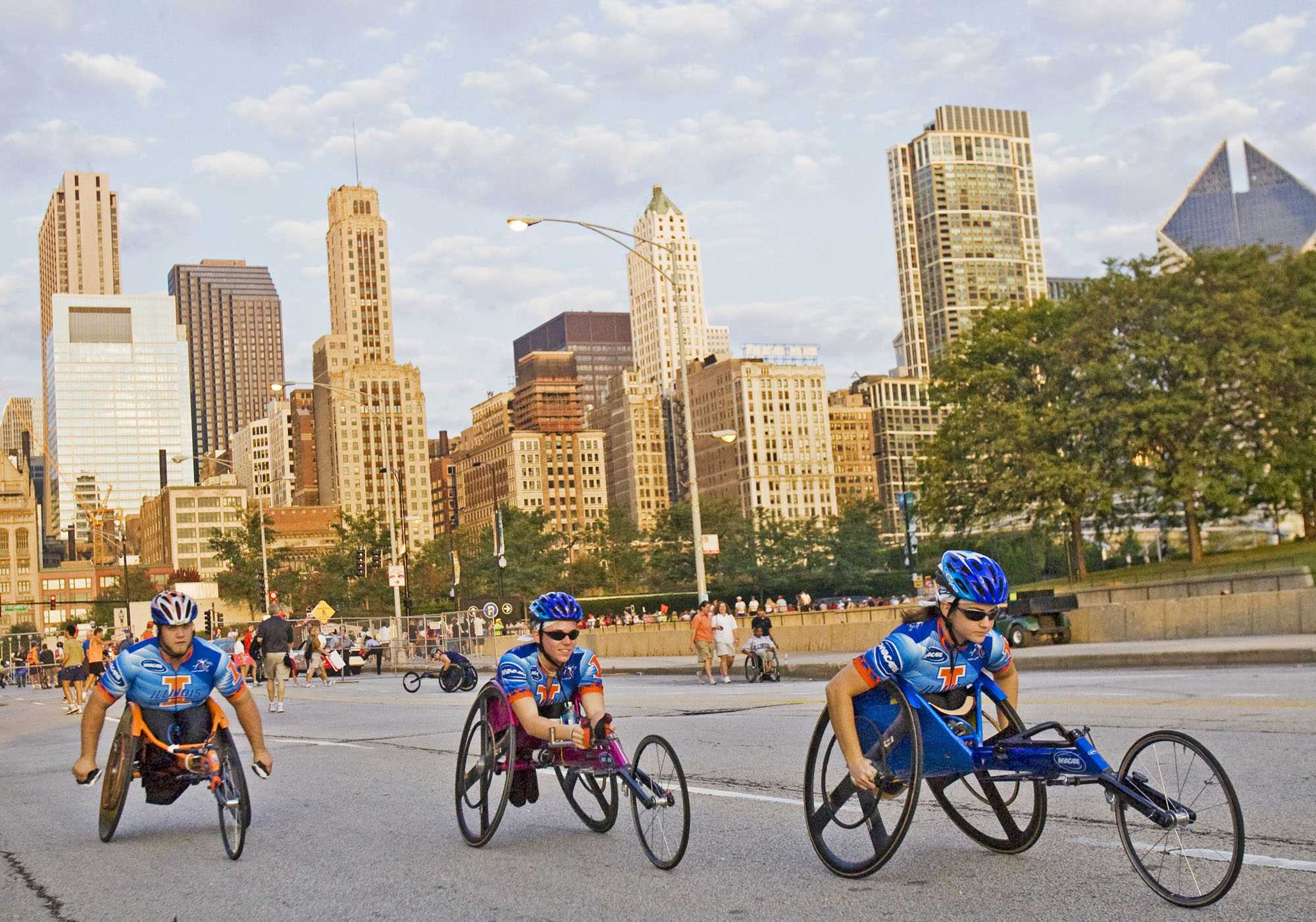 Josh+Birnbaum+The+Daily+Illini%0DIllinois+wheelchair+athletes+Chris+Taylor%2C+left%2C+Amanda+McGrory%2C+center%2C+and+Jessica+Galli+warm+up+before+competing+in+the+30th+Annual+Chicago+Marathon+on+Sunday+morning.++McGrory+won+the+women%27s+wheelchair+race+and+set+a+course+record+with+her+time+of+1%3A45%3A27.++Galli+finished+at+2%3A01%3A23+and+Taylor+came+in+at+2%3A18%3A11.