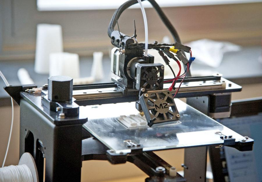 A 3-D printer at Westtown High School prints out parts for an artificial hand designed by Westtown engineering students for eight-year-old Steele Songle, April 18, 2014, in West Chester, Pa. (Ron Tarver/Philadelphia Inquirer/MCT)