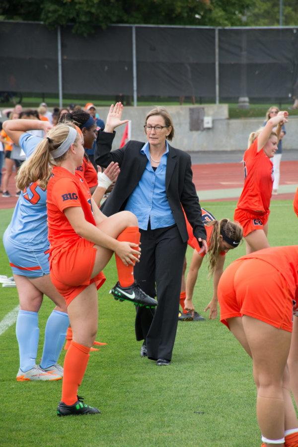 Coach+Janet+Rayfield+congratulates+her+players+after+their+2-1+double+overtime+victory+over+Maryland+at+Illinois+Soccer+and+Track+Stadium+on+Thursday.