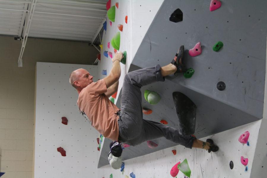 Experienced climberEric Pettengerattempts a difficult move Saturday at Urbana Boulders.