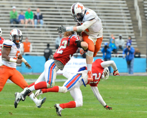 Illinois' Reilly O'Toole (4) jumps to avoid a tackle during the Zaxby's Heart of Dallas Bowl against Louisiana Tech at Cotton Bowl Stadium in Dallas, Texas on Friday, Dec. 26, 2014. The Illini lost 35-18.