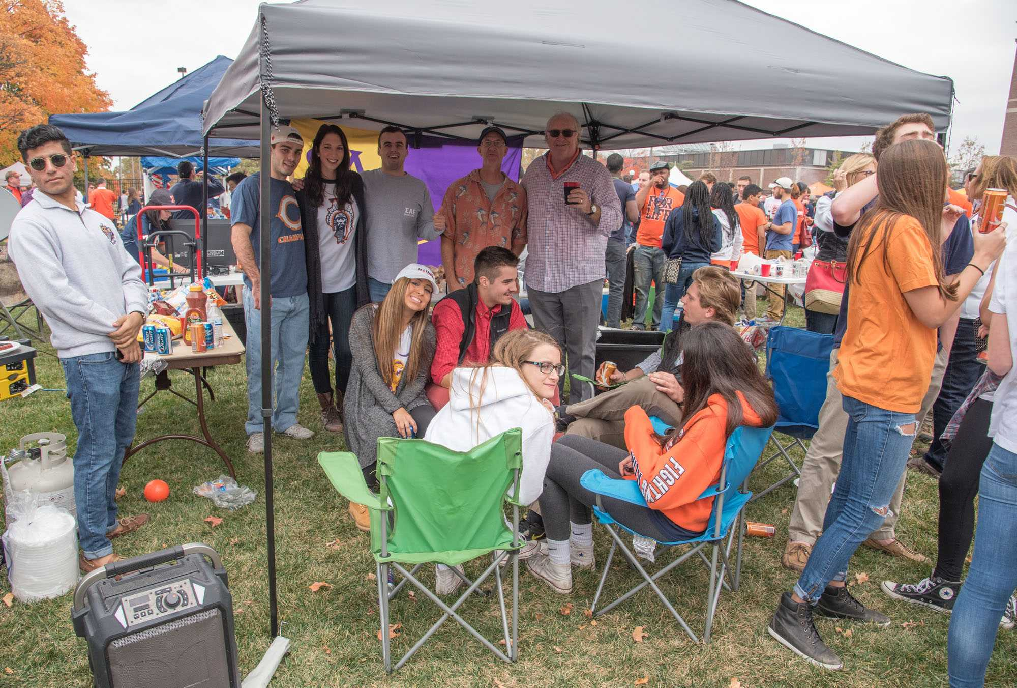 Past and current members of Sigma Alpha Epsilon celebrate Block at Grange Grove before a Homecoming football game.