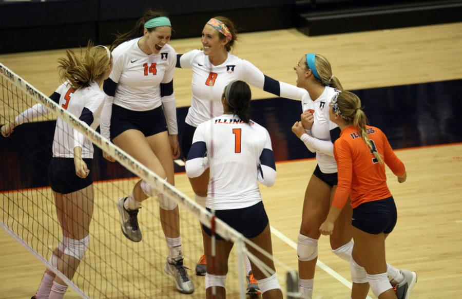 The+Fighting+Illini+Volleyball+team+celebrate+a+point+during+the+game+against+Rutgers+at+George+Huff+Hall%2C+on+Saturday%2C+Sept.+27.+The+Illini+won+3-0.