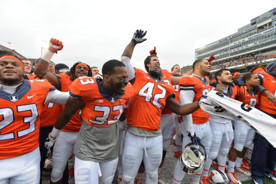 Illinois' Zepheniah Grimes (33) and Ralph Cooper (42) celebrate the win after the game against Penn State at Memorial Stadium on Saturday, Nov. 22, 2014. The Illini won 16-14.