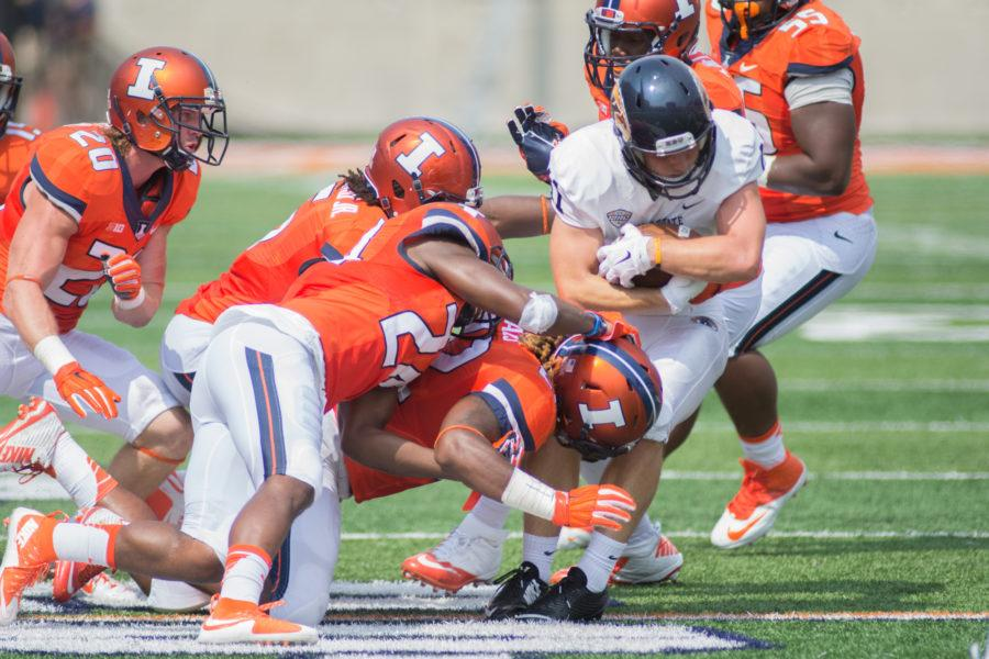 The+Illinois+defense+wraps+up+Kent+State+wide%C2%A0receiver+Connor+Arlia+during+their+season-opener+at+Memorial+Stadium+on+Saturday%2C+September+5.+Illinois+defeated+Kent+State+52-3.