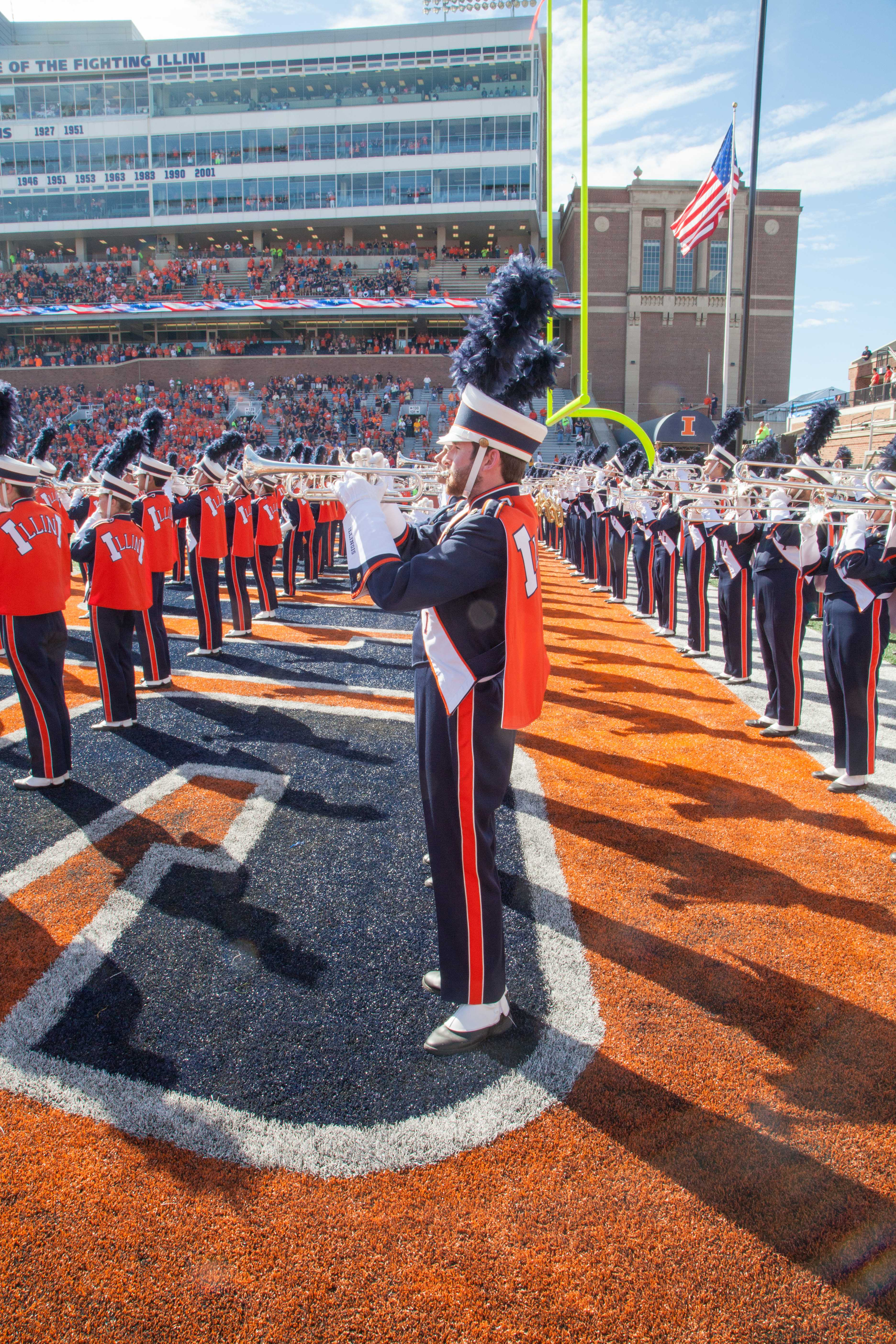 The+Marching+Illini+perform+for+the+crowd+before+the%C2%A0game.