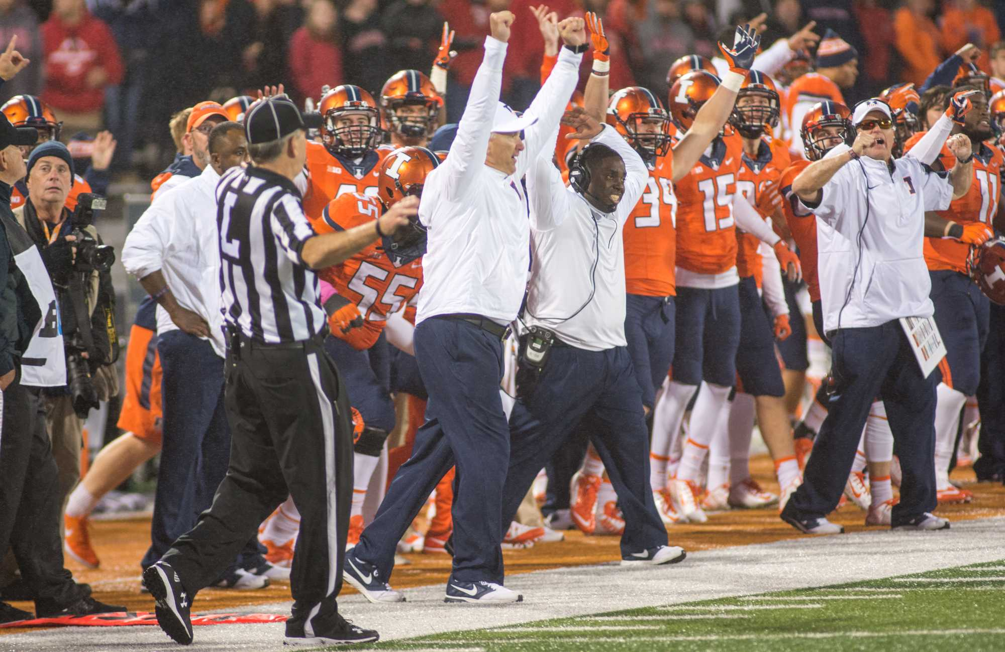 Head coach Bill Cubit and the Illinois sideline celebrate after Taylor Zalewski makes the PAT that put Illinois up 14-13 over Nebraska to win the game.