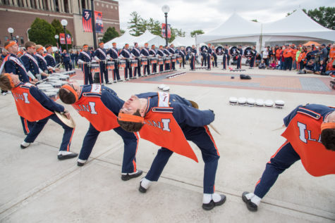 The Marching Illini drum-line performs for fans in Grange Grove before the game.