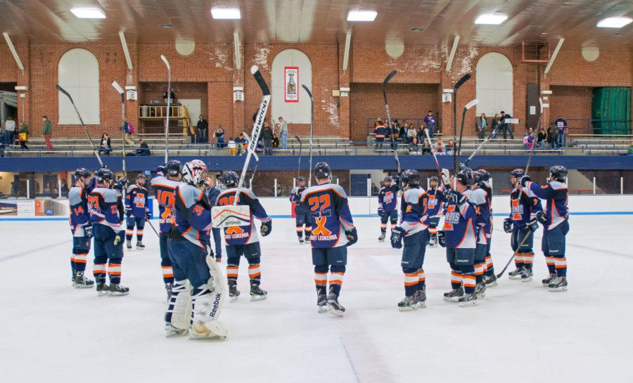 The+Fighting+Illini+hockey+players+salute+their+fans+after+beating+Robert+Morris+5-3+on+Saturday+at+the+Ice+Arena.+